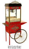 Early American styled popcorn machine with matching popcorn trolley. Full featured machine includes Old Maid's Tray and lower heating unit.